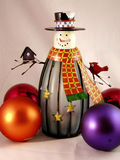 Snowman and ornaments. Decorative display of an abstract snowman and Christmas ornaments royalty free stock photos