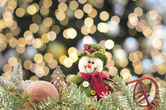 Snowman and ornaments with Christmas lights background Royalty Free Stock Photo