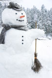 Snowman outside in snowfall Stock Photography