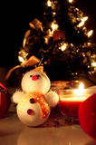 Snowman over Christmas tree background Royalty Free Stock Photography