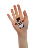 Snowman painted on child hand. Stock Image