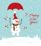 Snowman with a parachute and birds Royalty Free Stock Image