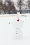 Snowman on a Parisian street. Funny snowman on a Parisian street Royalty Free Stock Image
