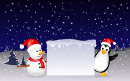 Snowman and penguin Christmas with blank sign Stock Photo