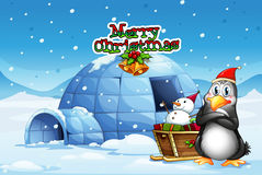 A snowman and a penguin in front of the igloo Royalty Free Stock Photo