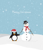Snowman with penguin Stock Photography