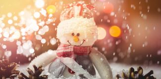 Snowman and pine cone on snow Royalty Free Stock Image