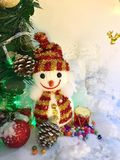 Snowman , pine tree , gift, bead and reindeer on Christmas day stock photography