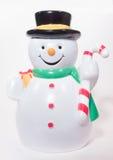 Snowman. A plastic Snowman statuette holding a candycane Stock Image