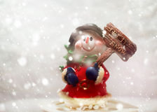Snowman with plate Let it snow. Snowman in snowfall with plate Let it snow!. Christmas greeting card stock photos