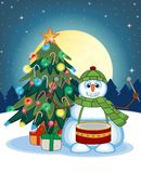Snowman Playing Drums Wearing A Green Head Cover And A Scarf With Christmas Tree And Full Moon At Night Background For Your Design Stock Image
