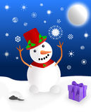 Snowman playing in the snow. Trying to catch a snowflake under a glowing moon, a present and accessories indicate it's Christmas Royalty Free Stock Image