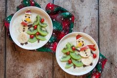 Snowman porridge oatmeal breakfast , Fun Christmas for kids Royalty Free Stock Photo