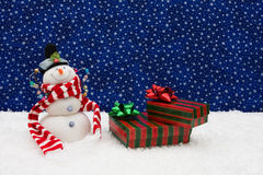 Snowman and Presents Royalty Free Stock Photography