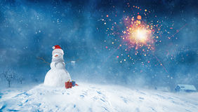 Snowman with presents at Winter night Stock Photos