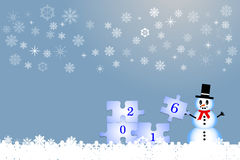 Snowman and the puzzle with the year 2016. Happy snowman is helping pass the puzzle with the year 2016.  All is on the trendy blue gradient background with light Stock Image
