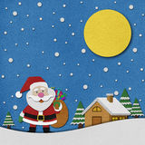 Snowman recycled paper craft on paper background. Stock Image