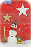 Snowman on red background Stock Photos