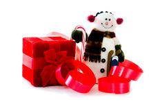 Snowman with red box and ribbons Stock Image