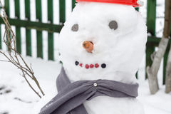 Snowman in Red Bucket Stock Photography