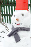 Snowman in Red Bucket Stock Image