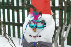 Snowman in Red Bucket Stock Photo