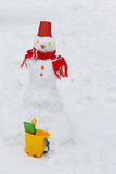 Snowman with red bucket Royalty Free Stock Images