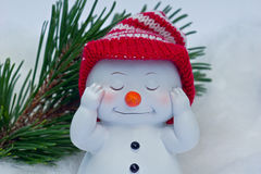 Snowman with red cap Stock Photography