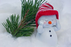 Snowman with red cap Stock Images