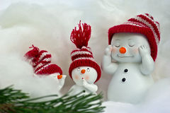 Snowman with red cap Royalty Free Stock Photos