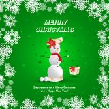 A snowman in a red cap emerges from a gift package on a green background and golden snowflakes. Festive greeting card for Christma. S and New Year Stock Image