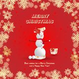 A snowman in a red cap emerges from a gift package on a red background and golden snowflakes. Festive greeting card for Christmas. And New Year Stock Photos