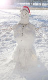 Snowman with red cap on wintry back Stock Images