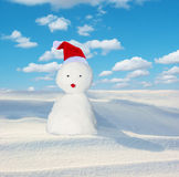 Snowman with red hat Royalty Free Stock Images