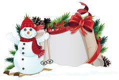 Snowman with red hat and scarf Royalty Free Stock Photography