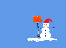 Snowman with red hat and shovel royalty free stock photography