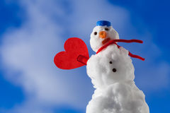 Snowman red heart love symbol outdoor. Winter. Royalty Free Stock Photo