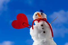 Snowman red heart love symbol outdoor. Winter. Stock Image