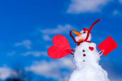 Snowman red heart paper card outdoor. Winter. Royalty Free Stock Photos