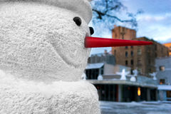 Snowman with a red nose in the city on Christmas and New Year Stock Photography