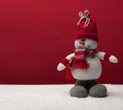 Snowman with red scarf and a cap Stock Photo