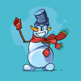 Snowman with red scarf pointing to the top Stock Photo