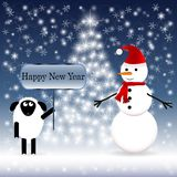 Snowman in a red scarf with a sheep Royalty Free Stock Photography