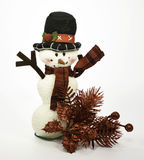 Snowman with red sprig Royalty Free Stock Images