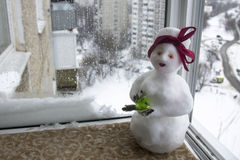 Snowman in a red and white scarf. stock photo