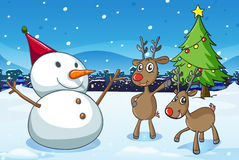 A snowman and the reindeers near the christmas tree Stock Photos