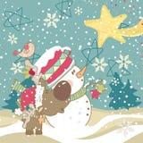 Snowman, ren och fallande stjärna Royaltyfria Foton