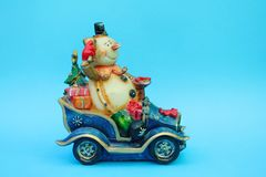 Snowman ride a car on blue background stock photo