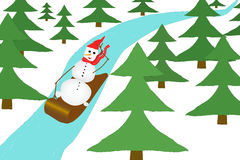 Snowman riding on a sled Stock Image