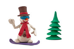Snowman riding a snowboard Stock Images